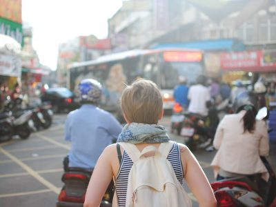 girl walking through a foreign city during her gap year
